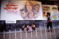 Myanmar (Burma), Yangon (Rangoon), Billboards in front of a cinema advertising an Indian film. Indian films in Hindi and American films in English are both popular in Yangon. - Steve Raymer