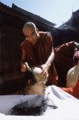 Myanmar (Burma), Initiation of novice Buddhist monks by shaving head - John McDermott