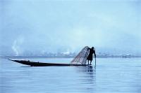 Myanmar (Burma), Inle Lake, silhouette of fisherman in boat on Inie Lake - John McDermott