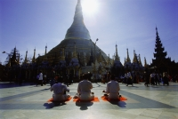 Myanmar (Burma), Yangon (Rangoon), Silhouette of worshippers praying at the Shwedagon Pagoda - John McDermott