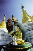 Myanmar (Burma), Yangon (Rangoon), Statue of Buddha at Shwedagon Pagoda - John McDermott