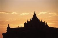 Myanmar (Burma), Bagan, Silhouette of people on temple at Bagan at sunset - John McDermott