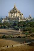 Myanmar (Burma), Bagan, Villagers walking along dirt roads with temples in backgrounds - John McDermott