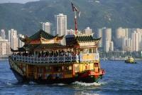 Hong Kong, Victoria Harbor, Double-decker boat, buildings in background. - Jack Hollingsworth
