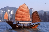 Hong Kong, Victoria Harbor, Chinese junk, buildings in background. - Jack Hollingsworth