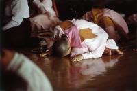 Myanmar (Burma), Yangon (Rangoon), A group of young Buddhist monks meditating at a meditation center. - Steve Raymer