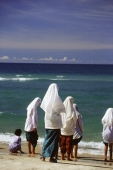 Thailand, Bangkok, Muslim girls in traditional dress by the beach - John McDermott