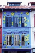 Singapore, Chinatown, Painted facade of shophouse. - Steve Raymer