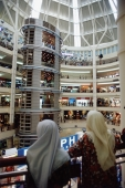 Malaysia, Kuala Lumpur, Malaysians inside the Kuala Lumpur City Center shopping mall. - Steve Raymer