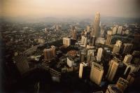 Malaysia, Kuala Lumpur, Aerial view of Petronas Towers and downtown Kuala Lumpur. - Steve Raymer