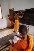 Vietnam, Mekong Delta region, Bac Lieu, Buddhist monks in classroom. - Steve Raymer
