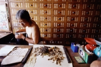 Vietnam, Mekong Delta region, Bac Lieu, man at Chinese medicine dispensary. - Steve Raymer