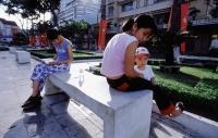 Vietnam, Ho Chi Minh City (Saigon), Vietnamese relaxing in Lam Son Square. - Steve Raymer