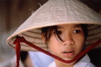 Vietnam, Mekong Delta region, Long Xuyen, Female Vietnamese rice farmer. - Steve Raymer