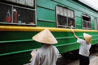 Vietnam, Locals outside the Reunification express that runs from Ho Chi Minh City (Saigon) to Hanoi - Jill Gocher