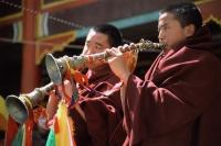 China, Szechuan (Sichuan), Kham region, Monks playing horns during monastery festival. - Jill Gocher