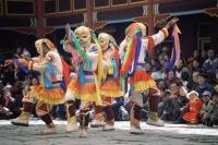 China, Szechuan (Sichuan), Kham region, Lamastic dancers  performing masked lama dance at monastery - Jill Gocher