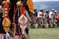 China, Szechuan (Sichuan), Kham region, Khampa women dancing in traditional costumes during summer nomad festival. - Jill Gocher