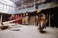 Nepal, Mustang, Buddhist Lamas perform ceremonial dances during Teeji Festival. - Jill Gocher