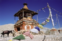Nepal, Mustang, A man and horse near a Chorten, which marks the boundary between neighboring districts. - Jill Gocher