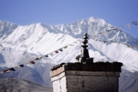 Nepal, Mustang, Ancient chortens, mountains in background. - Jill Gocher