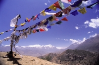 Nepal, Mustang, Prayer flags at the top of trail, Annapurna Range in background. - Jill Gocher