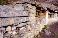 Nepal, Muktinath, Carved Mani stones and prayer wheels - Jill Gocher