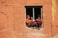 Nepal, Lo Manthang, Young monks sit on window sill and study for exams - Jill Gocher