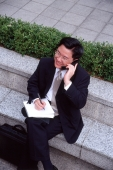 Man in business suit, using mobile phone - Alex Microstock02