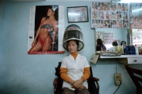Vietnam, Hanoi, woman sitting underneath hair dryer - Alex Mares-Manton