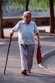 China, Beijing, old woman walking with cane - Alex Mares-Manton