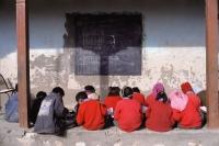 India, Ladakh, School children having lessons. - Mary Grace Long