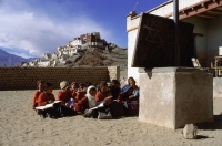 India, Ladakh, School children having lessons. - Mary Grace Long