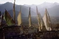 India, Northern India, Srinagar-Leh Road, Prayer flags at dawn, mountains at background. - Mary Grace Long