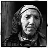 India, Ladakh, Leh, Portrait of elderly lady with head scarf. - Mary Grace Long