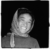 India, Ladakh, Portrait of young girl smiling. - Mary Grace Long