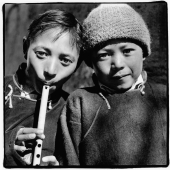 India, Northern India, Srinagar-Leh Road, Portrait of two young boys, one playing recorder. - Mary Grace Long