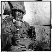 India, Ladakh, Leh, Portrait of Tibetan man holding prayer wheel and prayer beads. - Mary Grace Long