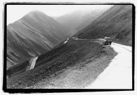 India, Northern India, Srinagar-Leh Road, Car parked along road, mountains at background. - Mary Grace Long