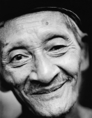 Indonesia, Java, Blitar, Portrait of man smiling. - Mary Grace Long