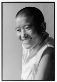 India, near Dharamsala, Dolma Ling Nunnery, Portrait of Tibetan nun smiling. - Mary Grace Long