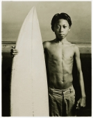 Indonesia, Bali, Kuta Beach, Young surfer holding surfboard on the beach. - Martin Westlake