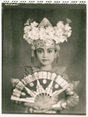 Indonesia, Bali, Amlapura, Legong dancer in full costume holding fan. - Martin Westlake