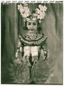 Indonesia, Bali, Amlapura, Condong dancer in full costume holding golden wings. - Martin Westlake