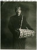 Indonesia, Bali, Amlapura, Gamelan player holding drum. - Martin Westlake