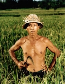 Indonesia, Bali, Candi Dasa, Balinese rice farmer in rice field. - Martin Westlake