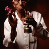 Indonesia, Bali, Ubud, Hindu priest holding prayer bell and  flower. - Martin Westlake