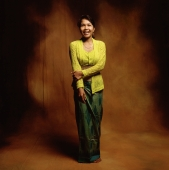 Indonesia, Bali, Ubud, Young Balinese woman in temple dress smiling. - Martin Westlake