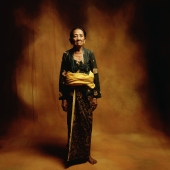 Indonesia, Bali, Ubud, Mature Balinese woman in ceremonial dress. - Martin Westlake