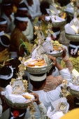 Indonesia, Bali, Gianyar, Pengastian ceremony, worshippers carrying offerings.  (grainy) - Martin Westlake